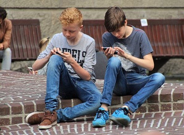 Kids playing on their phones
