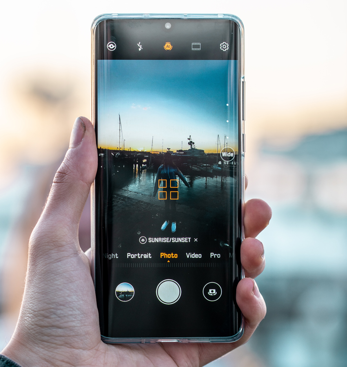 A Huawei P30 Pro in a persons hand taking a picture